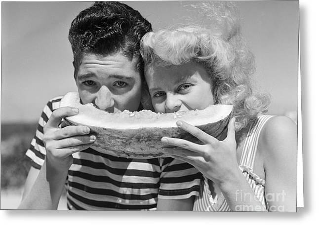 Teen Couple Sharing Watermelon, C.1950s Greeting Card by H. Armstrong Roberts/ClassicStock