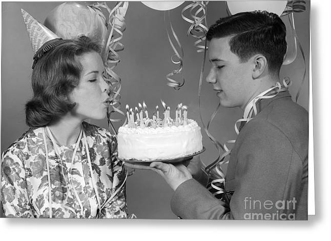 Teen Girl Blowing Out Birthday Candles Greeting Card