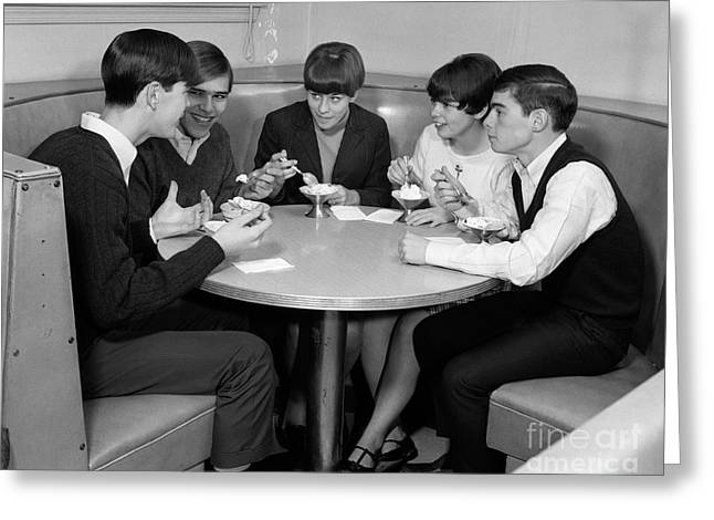 Teenagers In A Cafe, C.1960s Greeting Card by H. Armstrong Roberts/ClassicStock