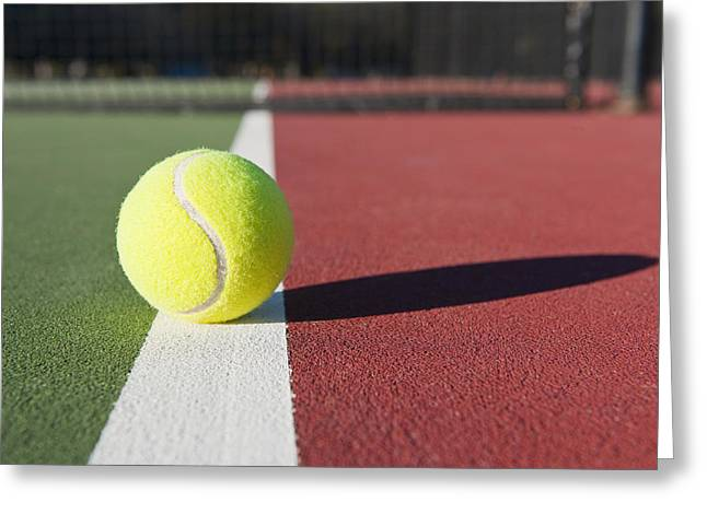 Tennis Ball Sitting On Court Greeting Card by Thom Gourley/Flatbread Images, LLC