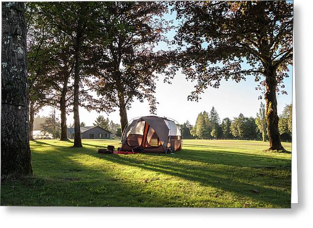 Tent Setup For Camping In The Countryside At Sunset Greeting Card by Bradley Hebdon