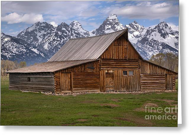 Tetons Towering Over The Moulton Barn Greeting Card by Adam Jewell