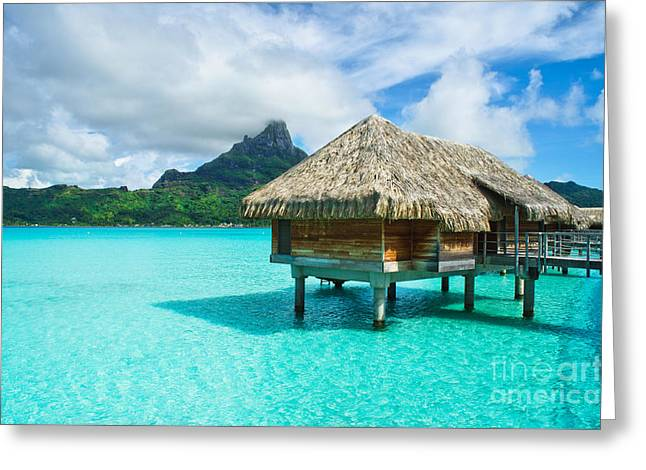 Greeting Card featuring the photograph Thatched Roof Honeymoon Bungalow On Bora Bora by IPics Photography