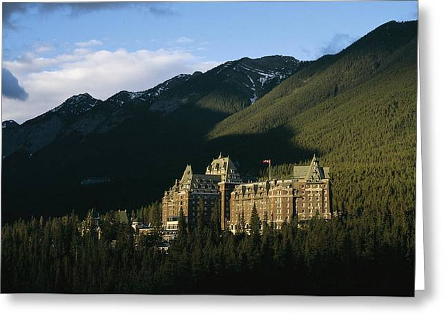 Hotels And Resorts Greeting Cards - The Banff Springs Hotel, Nestled In An Greeting Card by Michael S. Lewis