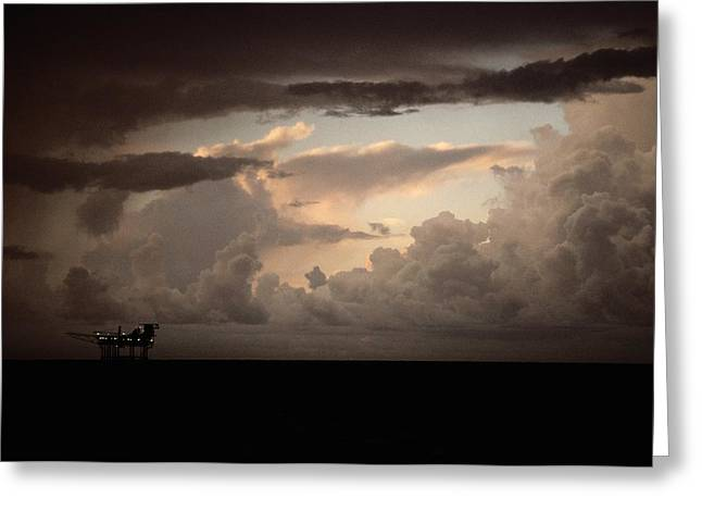 The Faint Lights Of A Gas Platform Greeting Card by Wolcott Henry