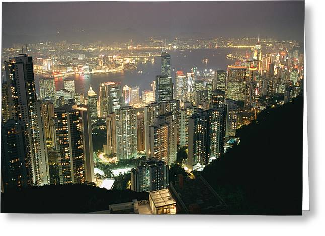 The Hong Kong Skyline Is Lit Greeting Card by Paul Chesley