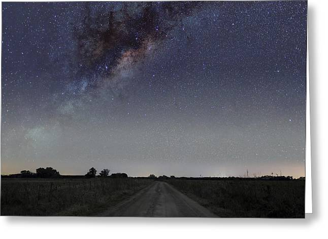 Constellation Greeting Cards - The Milky Way Galaxy Over A Rural Road Greeting Card by Luis Argerich