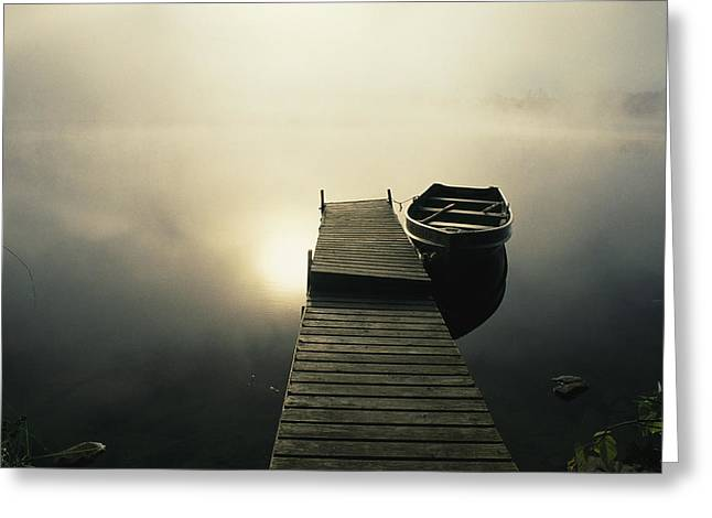 Etc Greeting Cards - The Morning Sun Shine On A Rowboat Tied Greeting Card by Stephen Alvarez