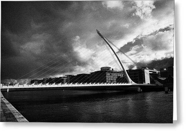 Tiger Economy Greeting Cards - the new Samuel Beckett Bridge across the river liffey in Dublin republic of ireland under dark grey  Greeting Card by Joe Fox