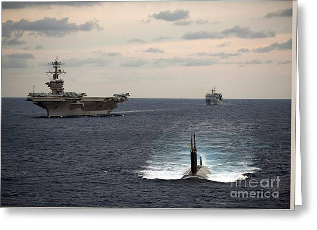 The Nimitz-class Aircraft Carrier Uss Carl Vinson And A Submarine Greeting Card by Celestial Images