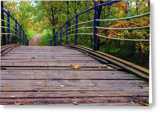 the old bridge over the river invites for a leisurely stroll in the autumn Park Greeting Card
