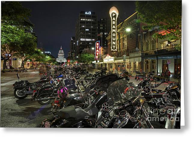 The Paramount An State Theatre Neon Signs Illuminate The Motorcycles Lined Up Congress Avenue Greeting Card by Herronstock Prints