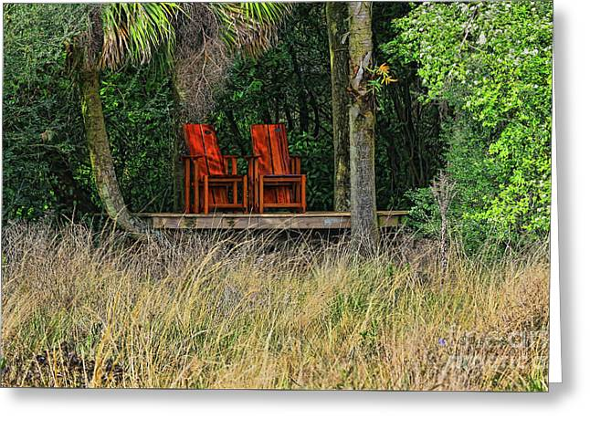 Greeting Card featuring the photograph The Red Chairs by Deborah Benoit