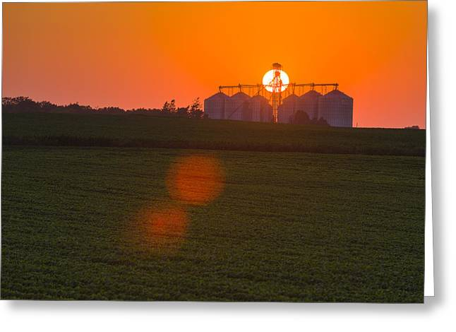 The Sun Sets Behind A Large Commercial Greeting Card