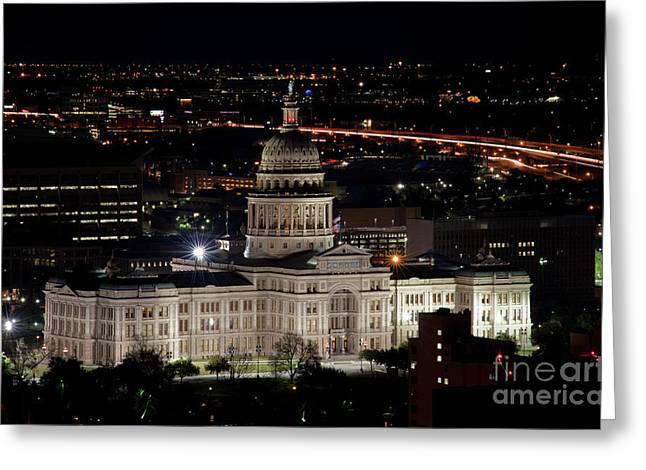 The Texas State Capitol At Night As Rush Hour Traffic Lights Str Greeting Card by Herronstock Prints