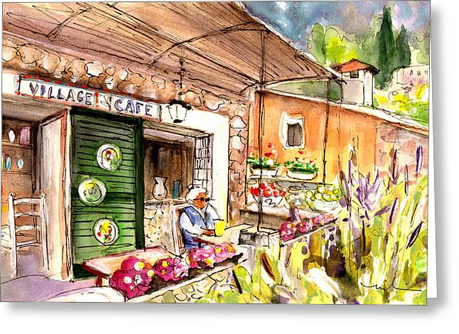 The Village Cafe In Deia Greeting Card by Miki De Goodaboom