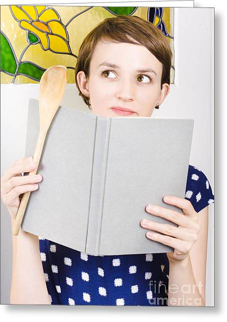 Thinking Woman Reading Cookbook In Kitchen Greeting Card