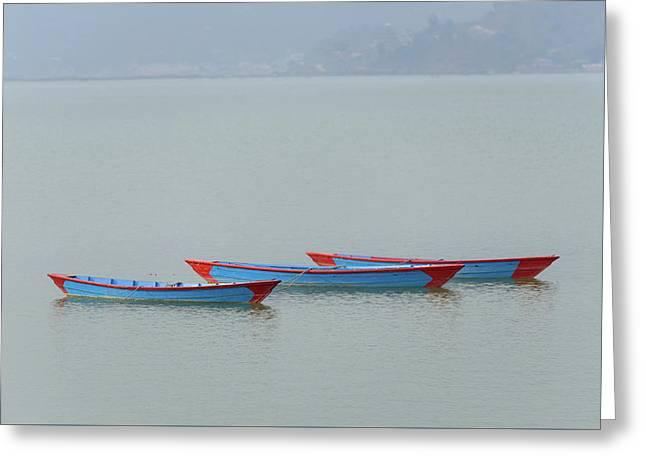 Three Blue Boats On Phewa Lake In Pokhara Greeting Card