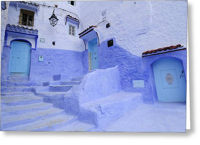Three Blue Doors In Chefchaouen  Greeting Card by Liz Pinchen
