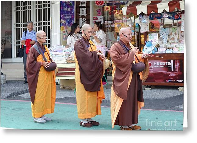 Greeting Card featuring the photograph Three Buddhist Monks Chant Scriptures by Yali Shi