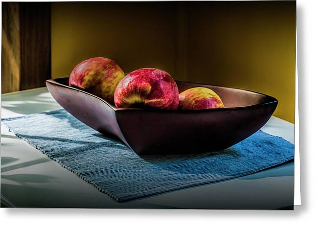 Three Red Apples In A Bowl Greeting Card by Randall Nyhof