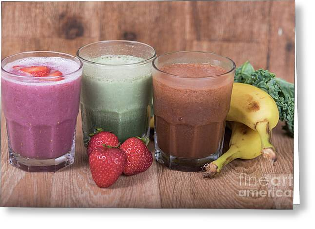 Three Smoothie Shakes With Bananas And Strawberries Greeting Card