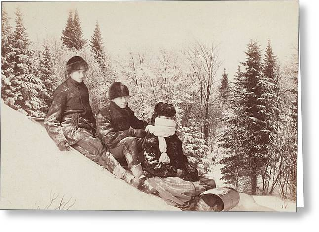 Three Tobogganers On A Snowy Hill Greeting Card