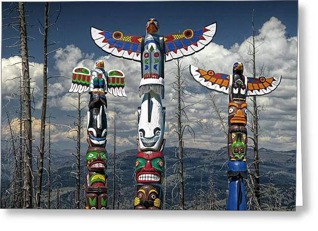 Three Totem Poles In The Northwest Greeting Card by Randall Nyhof
