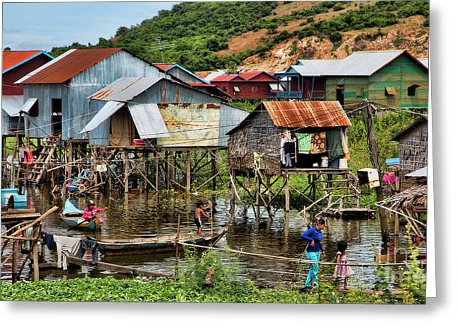 Tonle Sap Boat Village Cambodia Greeting Card by Chuck Kuhn