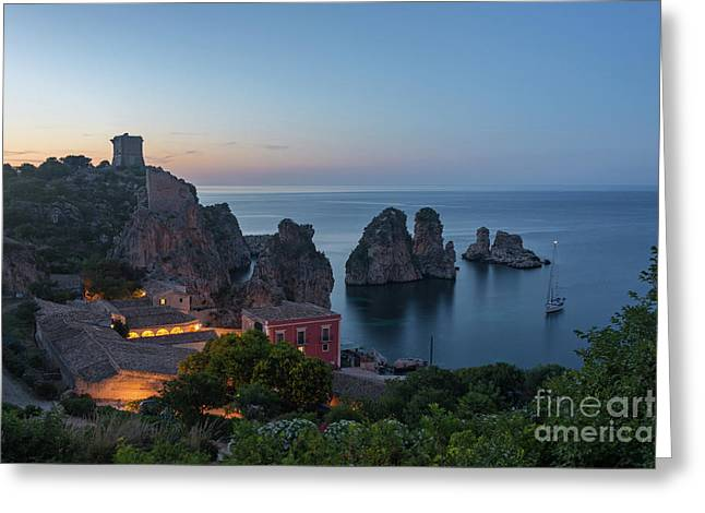 Greeting Card featuring the photograph Tonnara And Faraglioni Rocks In Scopello At Dusk by IPics Photography