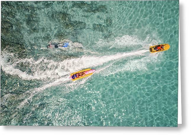 Top View Of Banana Boat Playing And Diving In Koh Larn Greeting Card by Anek Suwannaphoom