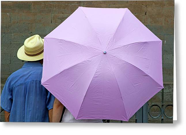 Tourist Looking At A Wall While Sheltering Under An Umbrella Greeting Card