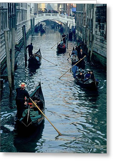 Tourists Travelling On Gondolas Through A Narrow Canal In Venice Greeting Card
