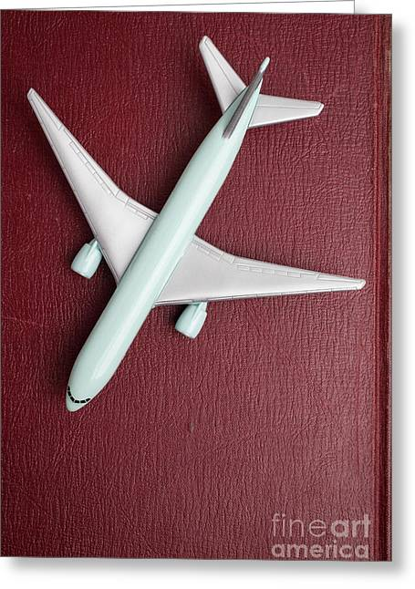 Toy Airplane Over Red Book Cover Greeting Card by Edward Fielding