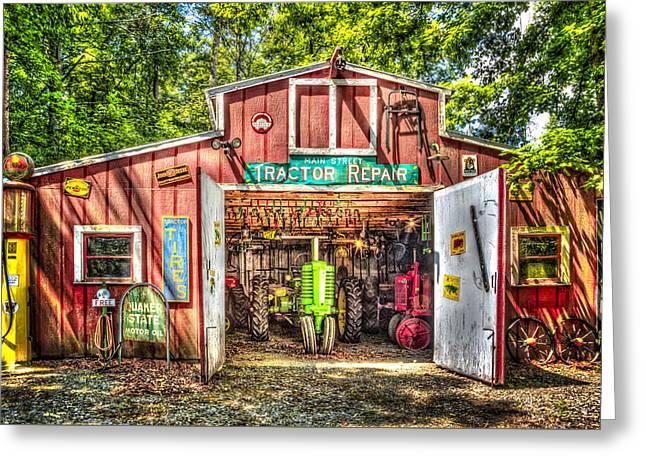 Tractor Repair Shoppe Greeting Card by Debra and Dave Vanderlaan