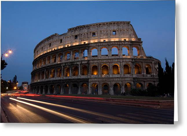 Traffic Goes By The Colosseum At Night Greeting Card by Joel Sartore