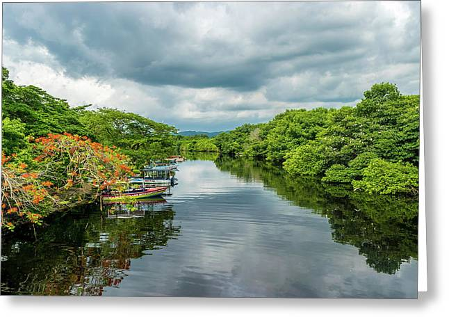 Cloudy Skies Over The River Greeting Card