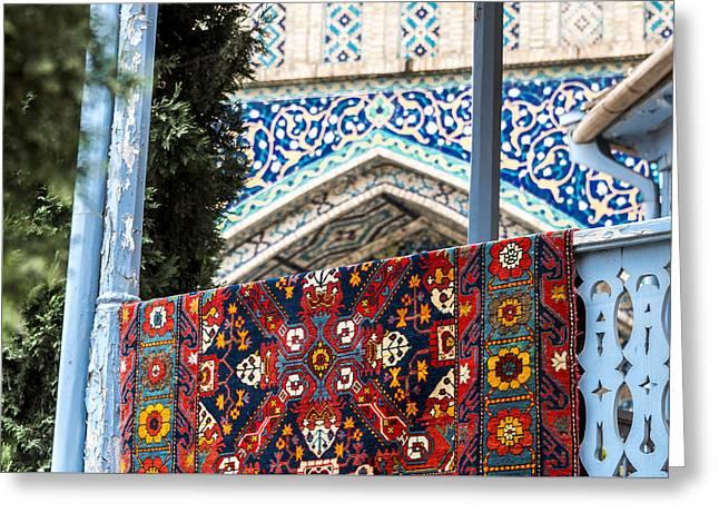 Turkish Carpet Drying Greeting Card by John Grummitt