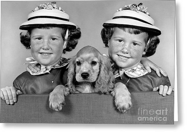 Twin Girls And Puppy, C.1950-60s Greeting Card by H. Armstrong Roberts/ClassicStock