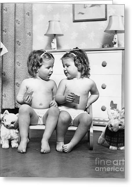 Twin Girls Sitting In A Double Seat Greeting Card by H. Armstrong Roberts/ClassicStock