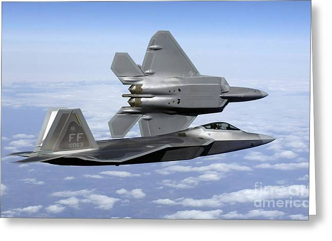 Attack Aircraft Greeting Cards - Two F-22a Raptors In Flight Greeting Card by Stocktrek Images