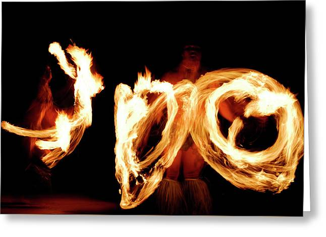 Two Fire Dancers Spinning Lit Batons At Night After A Luau Greeting Card by Reimar Gaertner