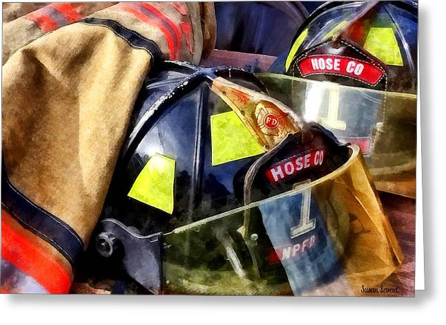 Two Fire Helmets And Fireman's Jacket Greeting Card by Susan Savad