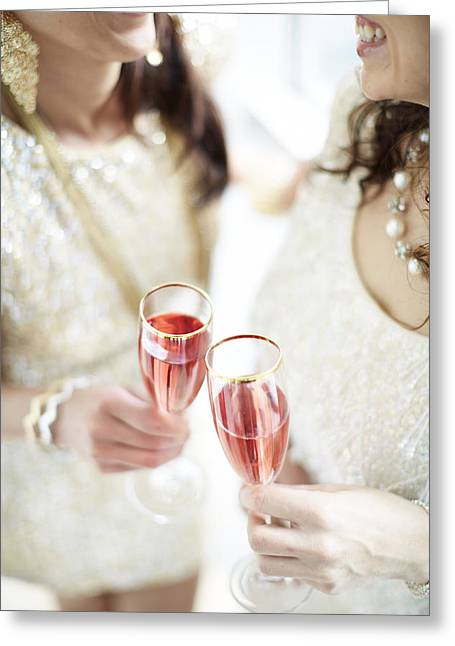 Two Giggling Ladies Toasting Champagne Greeting Card by Gillham Studios