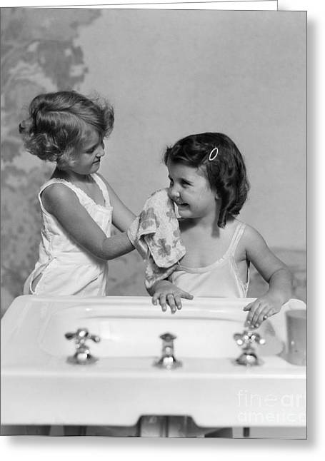 Two Girls At Bathroom Sink, C.1930s Greeting Card by H. Armstrong Roberts/ClassicStock