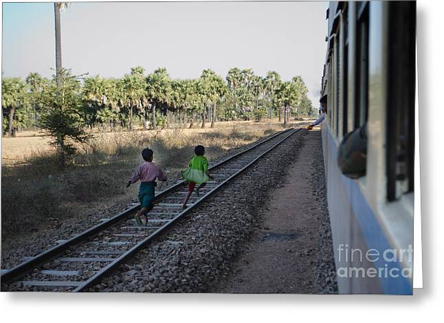 Two Kids Run Along And Follow Train In Burma Greeting Card by Jason Rosette