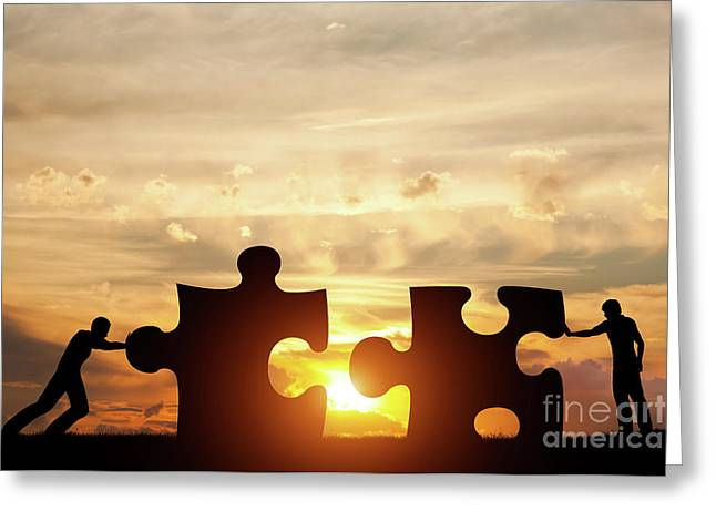 Two Men Connect Two Puzzle Pieces. Concept Of Business Solution, Solving A Problem. Greeting Card by Michal Bednarek