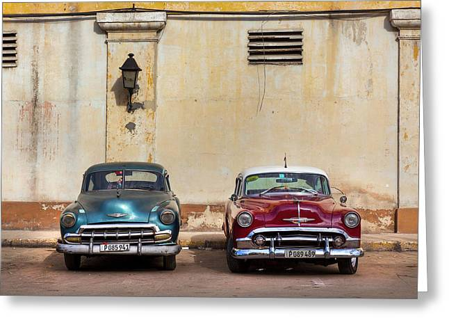 Greeting Card featuring the photograph Two Old Vintage Chevys Havana Cuba by Charles Harden