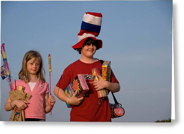 Two Siblings Hold Fireworks On A Gravel Greeting Card by Joel Sartore