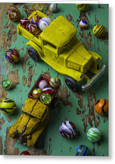 Two Toy Trucks With Marbles Greeting Card by Garry Gay